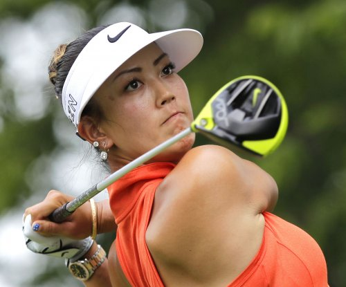 Michelle Wie sets course record, leads Women's British Open