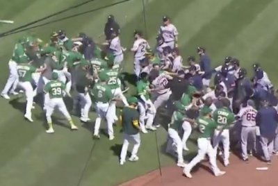 Athletics, Astros empty dugouts for mid-game brawl