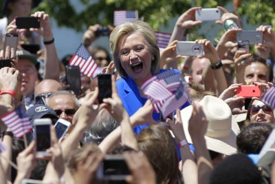 Hillary Clinton, Jeb Bush court voters with dueling messages