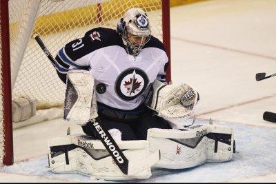 Winnipeg Jets recall G Ondrej Pavelec, place D Ben Chiarot on IR