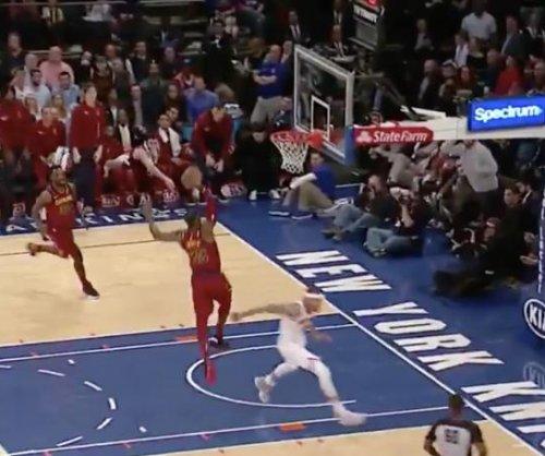 LeBron James throws down dunk while Michael Beasley runs away