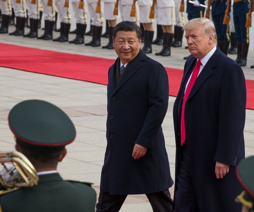 China reduces tariffs on imported cars after Trump meeting