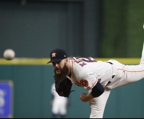 Astros aim to slow slide vs. rival Rangers