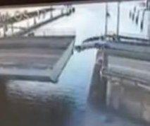 Netherlands motorist fails to jump open draw bridge