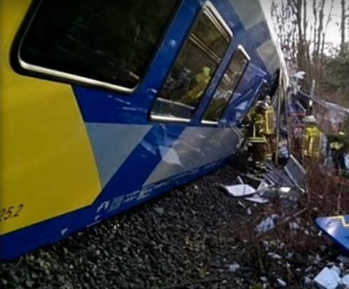 Germany train collision: At least 10 dead, dozens injured as officials search for cause