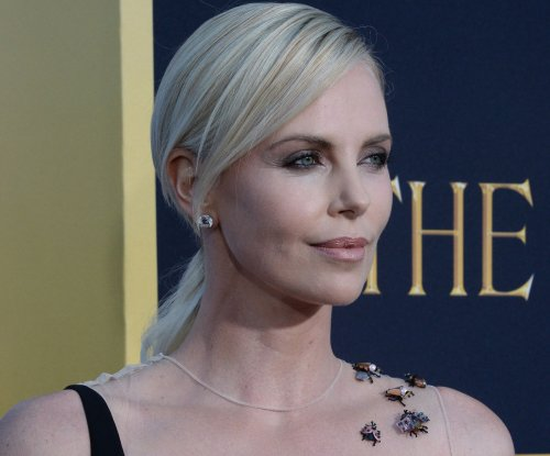 Charlize Theron says her 4-year-old son is 'in love' with her co-star Emily Blunt