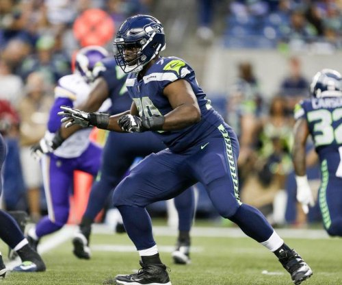 Seattle Seahawks LT Rees Odhiambo hospitalized after breathing issue; Chris Carson hurt
