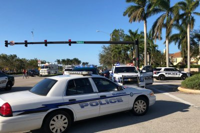 Ex-student arrested in Florida high school shooting; 17 dead