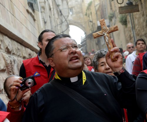 Thousands travel Good Friday path in Jerusalem
