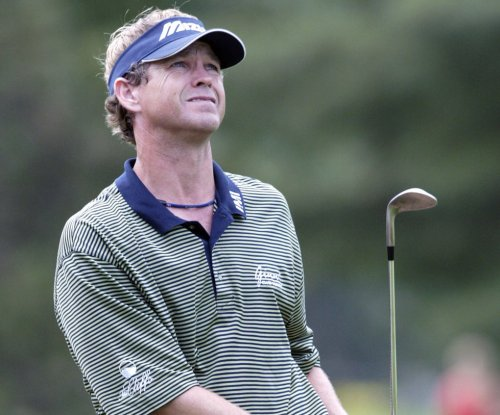 Paul Broadhurst holds Champions' lead
