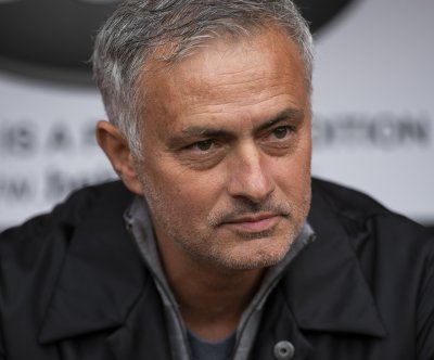 Tottenham hires Jose Mourinho as new coach