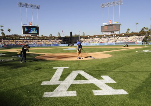 Lasorda, others raise funds for beaten fan
