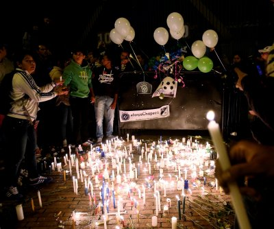Coffins of plane crash victims en route to Brazilian soccer stadium memorial