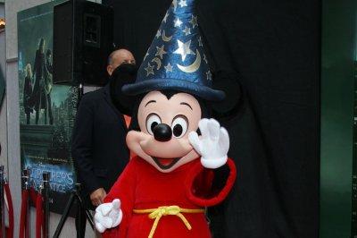 Shanghai Disneyland opens with rain, long lines