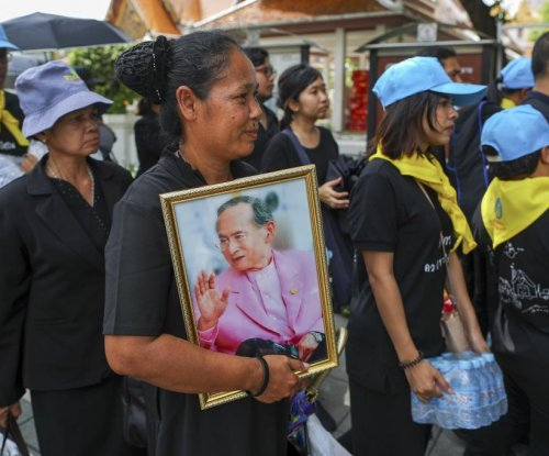 Thousands crowd Bangkok in run-up to King Bhumibol cremation