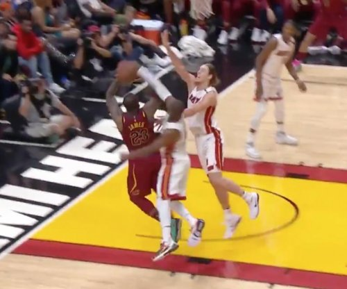Dwyane Wade blocks LeBron James' shot into the seats