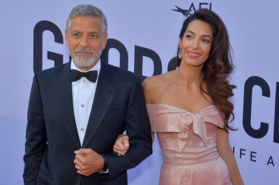 George Clooney praises his twins: 'They're fun and smart'