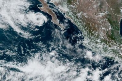 Tropical Storm Genevieve moves away from Baja California Peninsula
