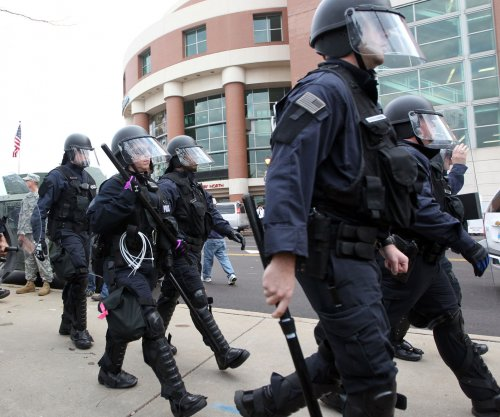 White House holds meetings to discuss Ferguson decison tensions, Holder in Atlanta