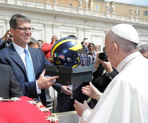 Jim Harbaugh meets Pope Francis, gives him unusual Michigan gifts