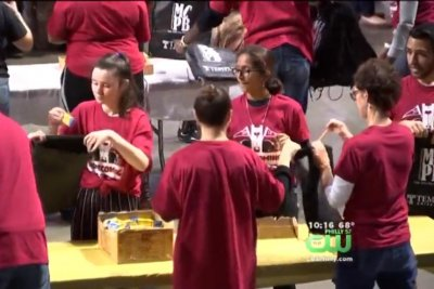 Students stuff 6,026 backpacks for Guinness record