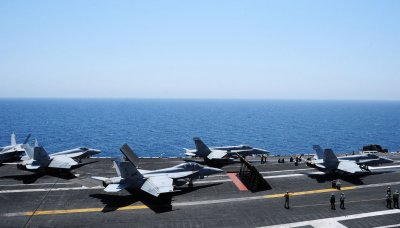 Jets crash into Pacific; one pilot still missing