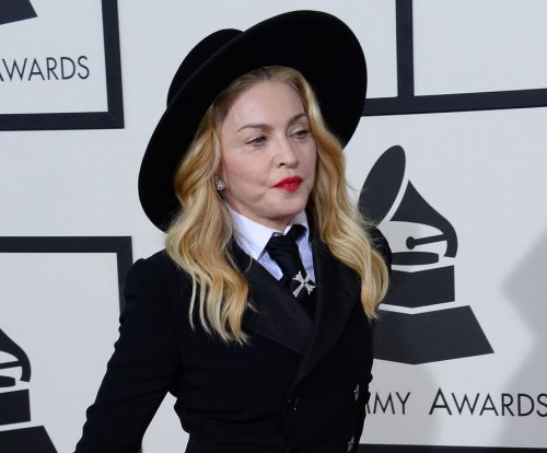 Madonna says she's fine after spectacular fall at Brit Awards