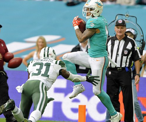 Miami Dolphins retain WR Kenny Stills, DE Andre Branch