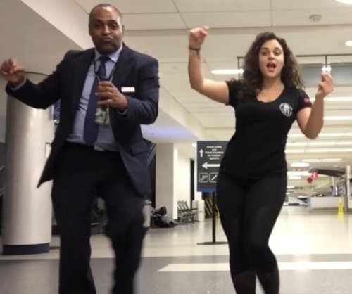 Woman stranded at airport recruits workers for dance party video
