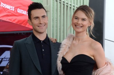 Behati Prinsloo shares intimate wedding, family photos