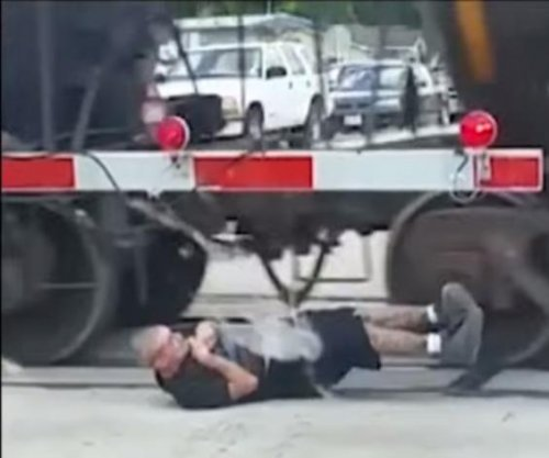 Police probe video of man rolling under moving freight train in Texas