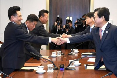 Two Koreas to hold basketball game, march together at Asian Games