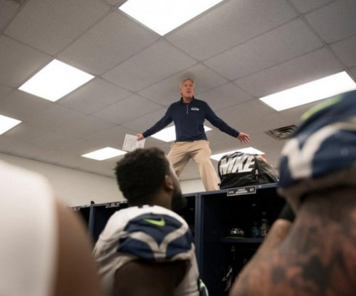 Pete Carroll climbs lockers after Seattle Seahawks win