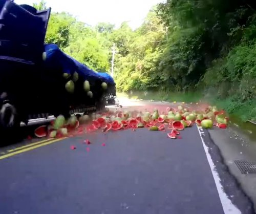 Watermelons falling from truck create road hazard