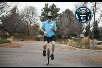 Man completes 463 juggling catches while riding unicycle blindfolded