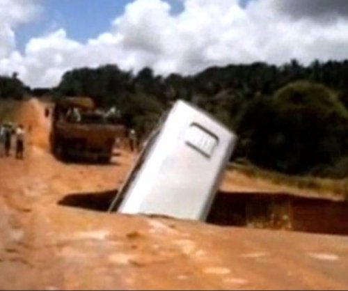 Brazilian bus falls through sinkhole, gets carried away by river