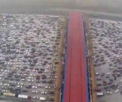 Chinese motorists trapped in 50-lane toll road traffic jam