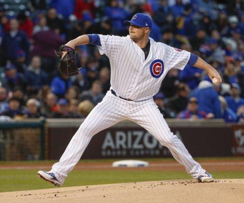 Jon Lester, Chicago Cubs labor past Philadelphia Phillies