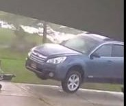 Security camera catches tornado winds lifting car