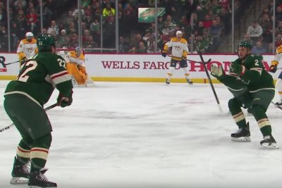 Wild's Kevin Fiala flips stick off ice to teammate Anthony Bitetto