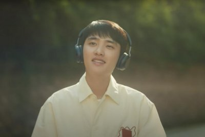 EXO's D.O. rides a bike in 'Rose' music video teaser