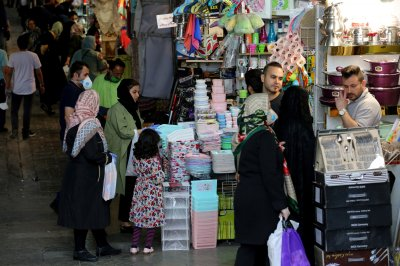 Iran orders people back to work amid coronavirus