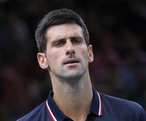 Novak Djokovic outlasts Stan Wawrinka to reach Australian Open final