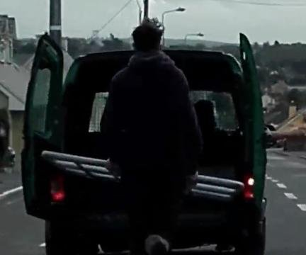 Video shows Irish man running behind van holding a gate