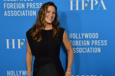 Jennifer Garner, Charlize Theron go chic at HFPA event