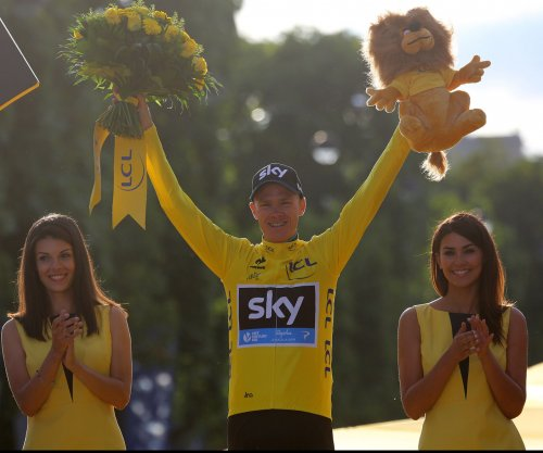Tour de France: Chris Froome extends lead after moment of silence