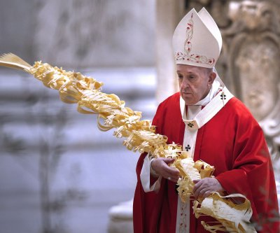 Pope celebrates Palm Sunday mass in nearly empty St. Peter's Basilica