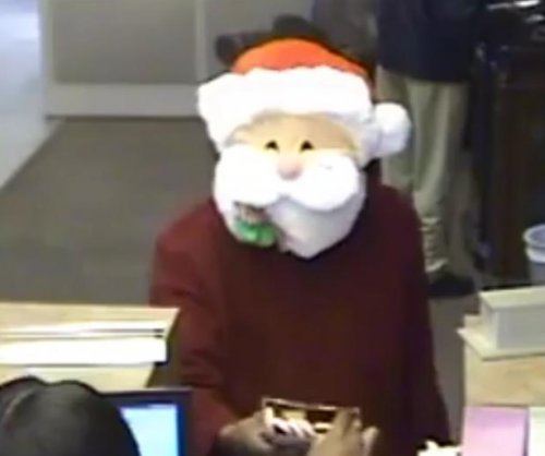 Naughty Santa plays nice by handing out candy canes before bank robbery