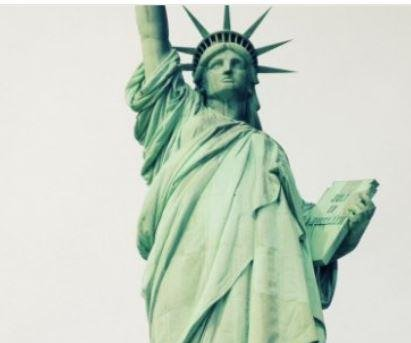 "Activists hang ""Welcome Refugees"" sign on Statue of Liberty"