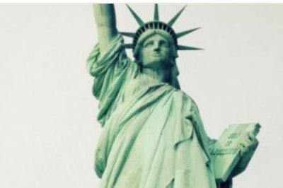 Activists hang 'Welcome Refugees' sign on Statue of Liberty